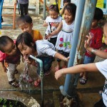 Kids in the community enjoying clean drinking water. Who wouldn't right?